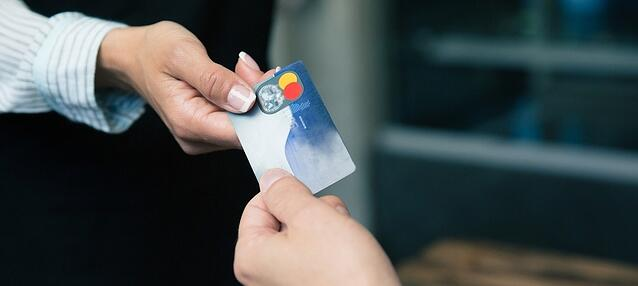 Closeup image of a man paying with credit card at the restaurant-852244-edited.jpeg